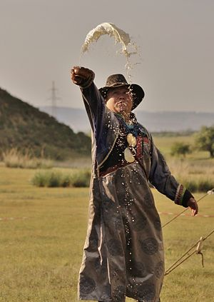 Libation - Buryat shaman performing a libation.