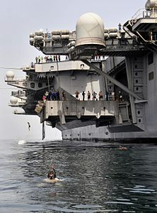 120323-N-OK922-139 ARABIAN SEA (March 23, 2012) Sailors jump off aircraft elevator No. 4 during a swim call aboard the Nimitz-class aircraft carrier USS Carl Vinson (CVN 70).jpg