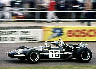 Silverstone Circuit -  Piers Courage on his way to 5th place in the 1969 British Grand Prix, aboard Frank Williams Racing Cars's Brabham-Cosworth BT26A