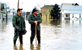 Indiana Air National Guard - Members of the Indiana Air National Guard participate in an emergency operation after recent flooding in Fort Wayne, Indiana, March 1, 1982.