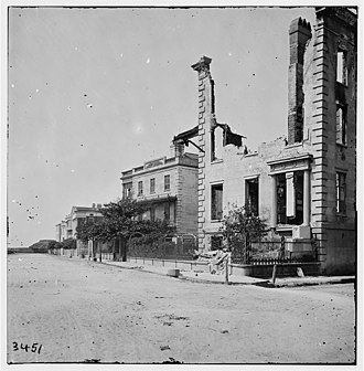 Charles Drayton House - During the Civil War, a former house was seriously damaged by shelling. The house at the far right in this 1865 photograph was torn down and replaced by the Charles Drayton House.