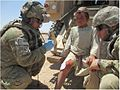 818th RCC medic provides aid to young Afghan DVIDS822797.jpg