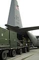 86th Maintenance Squadron personnel unload cargo from a C-130 Hercules aircraft in support of Ramstein's Mobility Excercise 2002 at Ramstein Air Base, Germany on 29 Jan 02 020129-F-EF469-002.jpg