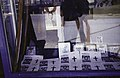 ASC Leiden - Rietveld Collection - East Africa 1975 - 05 - 009 - Mourning shop window display and notice with a portrait and a cross for politician Josiah Mwangi Kariuki, murdered in 1975 (mirrored image) - Nairobi, Kenya.jpg