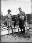 A man and a girl displaying their fishing catch at Lake Conjola (3550242311).jpg