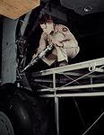 A mechanic greasing a landing gear.jpg