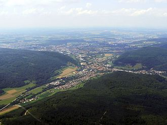 Aalen - Aerial view of the district of Unterkochen (the town centre is partly covered and in the background), the Aalen lowlands well perceptible in the back
