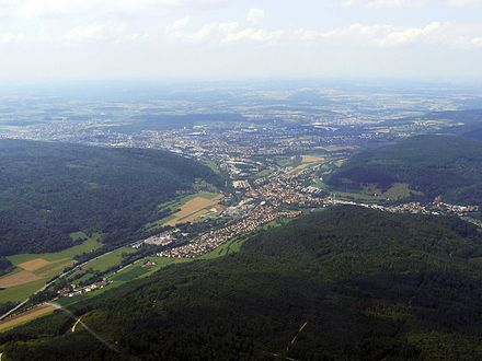 Aerial view of the district of Unterkochen (the town centre is partly covered and in the background), the Aalen lowlands well perceptible in the back