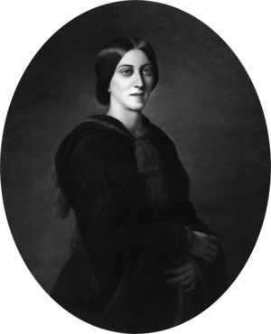 Three-quarter oval portrait of a slender woman aged about 30, garbed in black. Her deep-set eyes gaze solemnly over the viewer's shoulder. Her dark, straight hair is parted in the centre without a fringe, combed over the ears, and pulled back in a low bun.