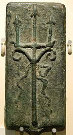 This is a oblong bronze bar with a cast image of a trident with (?) snakes