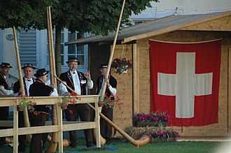 Swiss people - Alphorn players in a folklore festival