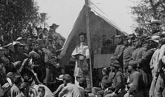 Chaplain Corps (United States Army) - A Roman Catholic army chaplain celebrating a Mass for Union soldiers and officers during the American Civil War (1861–1865).