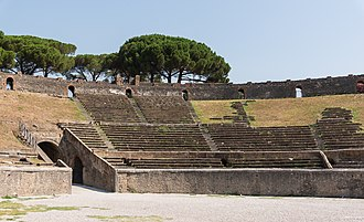 The Amphitheatre of Pompeii, built around 70 BC and buried by the eruption of Mount Vesuvius 79 AD, once hosted spectacles with gladiators. Amphitheatre 1 Pompeii.jpg