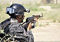 An Iraqi policeman with the Diyala province emergency response force, armed with a MKMS assault rifle, pulls security on a simulated crime scene during a police training exercise in Baquba, Iraq, May 15, 2011 110515-A-JR210-893.jpg