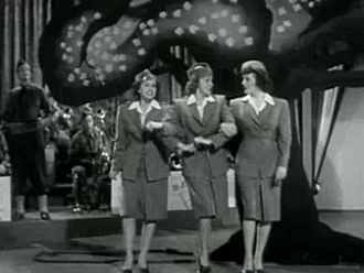 "1942 in music - The Andrew Sisters performing ""Don't Sit Under The Apple Tree"" in 1942."