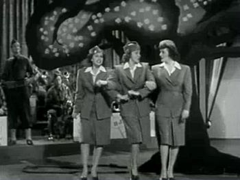 English: The Andrews Sisters, accompanied by H...