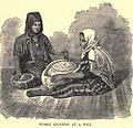 Arab women grinding 1886.jpg