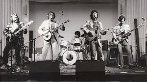Paul Downes - The Arizona Smoke Revue on stage at Greenwich, UK, 1982 (Paul Downes second from right)