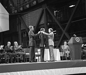 Congressional Space Medal of Honor - Neil Armstrong being awarded the first medal by President Jimmy Carter in 1978, with subsequent recipients Borman and Conrad seated.