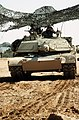 Army personnel man an M-1A1 Abrams main battle tank camouflaged with netting during Operation Desert Storm - DPLA - 20ebe682d435e338448c529601edbb9b.jpeg