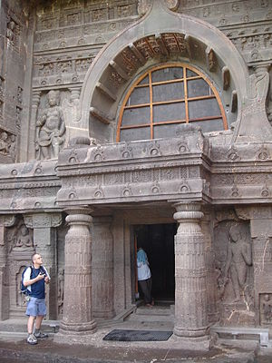 "Chaitya - Outside the chaitya at Cave 19, Ajanta Caves, also with four zones using small repeated ""chaitya arch"" motifs."