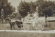 White horse-drawn fire engine