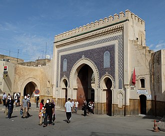 Bab Bou Jeloud - The monumental French gate of 1913 (right/center), alongside the much more modest original medieval gate (left).