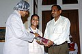 Baby Sarita Dwidedi, a 'Bala Shree' award winner helped by her father in receiving the award from the President, Dr. A.P.J. Abdul Kalam in New Delhi on 15, May 2006.jpg