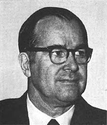 A headshot of Representative Barber Conable, a man in his 50s wearing a suit and thick-rimmed glasses