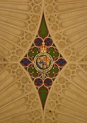 Honi soit qui mal y pense - The motto appears in a royal coat of arms of the 17th century on the ceiling of Bath Abbey.