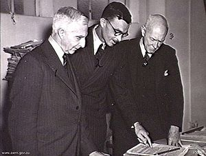 Australia in the War of 1939–1945 - C.E.W. Bean (left), Gavin Long (centre) and Allan S. Walker (right) discuss a manuscript in the Australian War Memorial's library in 1945