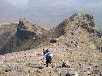 Scottish Outdoor Access Code - Hillwalkers descending from the summit of Beinn Dearg.