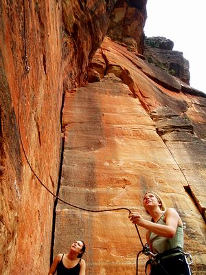 A belayer belaying a lead climber at Mt. Piddi...