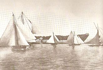 Bermuda Fitted Dinghy - Bermudian work boats racing. They feature the Bermuda rig, also used on the larger Bermuda sloop ships. These workboats, effectively scaled-down models of the seagoing sloops, were themselves scaled-down to produce the Bermuda Fitted Dinghy.