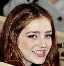 A picture of Birdy (Jasmine Van den Bogaerde) with brown hair, smiling, in October 2012.