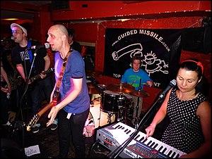 Bis (Scottish band) - Bis performing at London's Buffalo Bar in 2012. L-R: John Disco, Sci-fi Steven, Manda Rin.