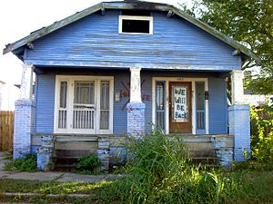 "9th Ward of New Orleans - Blue house on N. Robertson St., Upper 9th Ward. The door reads, ""We will be back."""