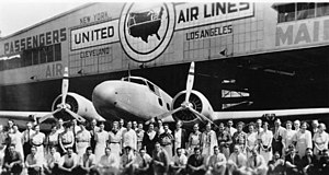 Boeing 247 - United Airlines crew members and employees stand in front of a Boeing 247