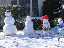 Photograph of four members of a snow family in Boise, Idaho in November 2010