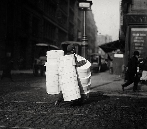 Boy carrying hats. New York City. - NARA - 523519 cropped