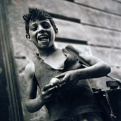 Boy enjoying fruit. Naples, August 1944.jpg