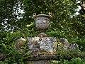 Bridge pan satyr urn at the Pleasure Grounds, Parham House, West Sussex, England.jpg