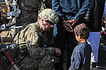 Brig. Gen. Sinclair connects with an Afghan child DVIDS489684.jpg