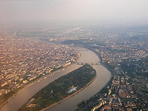 Budapest seen from north. Pest is on the left, Buda is on the right; Margaret Island in the foreground, Csepel Island at the farther end.