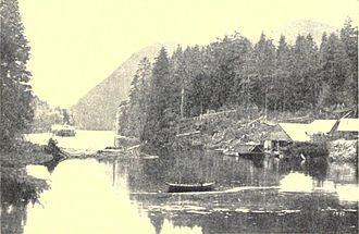 Loring, Alaska - The Loring Saltery as it appeared ca. 1887, located near the Naha Rapids. The townsite of Loring is located behind it at the base of the mountain in the background. The side wheel steamer Ancon is in the upper left. It wrecked on Loring's beach in August 1889