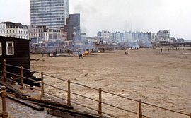 Burning debris from destroyed pier on Margate beach.jpg