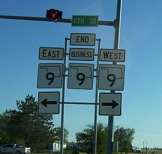 """Business route - Business SH-9 in Hobart, Oklahoma ends at its parent route. The center SH-9 shield is topped with a """"BUSINESS"""" plate, which is how business routes are typically marked."""