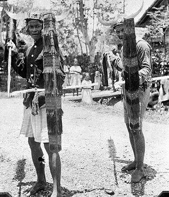 Donggala Regency - Indigenous people performing the Tjakalélé dance with spears and shields in Bora te Biromaru kampong