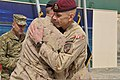 Canadian Army Brig. Gen. Wayne Eyre, right, the incoming commander of NATO Training Mission-Afghanistan (NTM-A), and Maj. Gen. Dean Milner, the NTM-A outgoing commander, embrace after signing transfer 140310-N-ZZ999-004.jpg