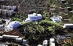 Large white buildings in a landscape garden.